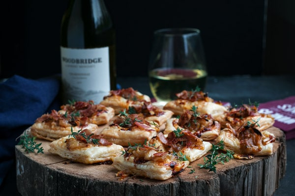 Caramelized Onion Puff Pastry Tartlets with White Wine, Cheddar, & Prosciutto